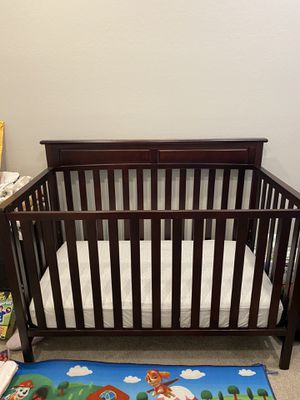 Dark brown Baby Crib with mattress. for Sale in Peoria, AZ