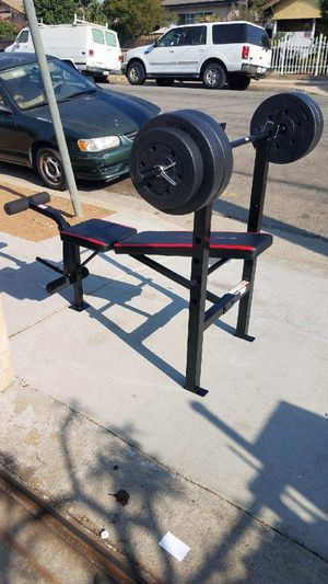 Standard width adjustable Bench press with bar and 100lbs for Sale in Montebello, CA