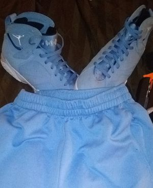 Perfect Condition Air Jordan Retro 7 Carolina Blue 10.5 w/Med. Jordan Shorts for Sale in Everett, WA