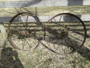 Old iron wagon wheels for Sale in Peculiar, MO