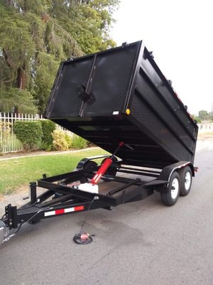 HEAVY DUTY DUMP TRAILER,BRAND NEW 8X12X4 CARRY 12000 LBS,HAS ELECTRIC BRAKES,HYDRAULIC SYSTEM,WITH REMOTE CONTROL,HEAVY DUTY CHAIN,SPARE TIRE for Sale in Chatsworth, CA