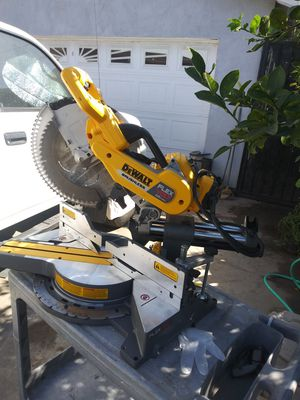 Like new slightly used cordless 12 inches sliding chopsaw with power inverter no batteries or charger for Sale in Rancho Dominguez, CA