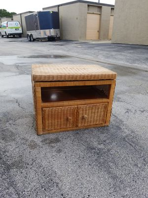 "Vintage Solid Wood and Wicker Tv Stand with Cabinet and Swivel Top that's in excellent condition! Dimensions: 26""L x 20""H x 16""D for Sale in Delray Beach, FL"