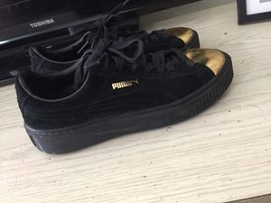 Black and gold pumas for Sale in Tampa, FL