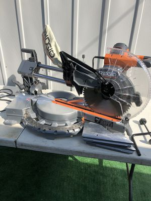 RIDGID 15 Amp Corded 12 in. Dual Bevel Sliding Miter Saw with 70 Deg. Miter Capacity and LED Cut Line Indicator for Sale in La Habra, CA