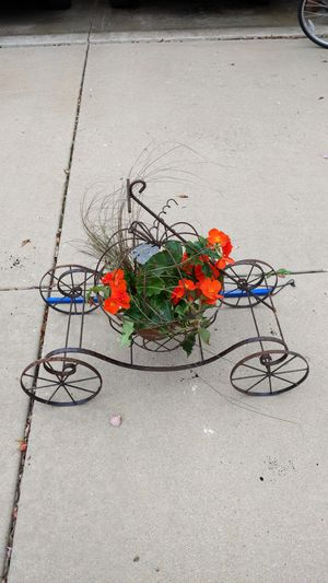 Perfect for Halloween Wrought Iron Flower Pot on Wheels with Handle for Sale in Aurora, IL