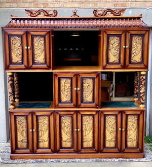 Ornate hand carved expandable bar cabinet and hand carved dragon table for Sale in Affton, MO