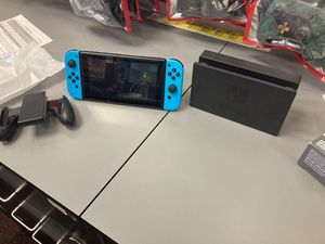 Nintendo switch V2 and 2 games for Sale in Manassas, VA