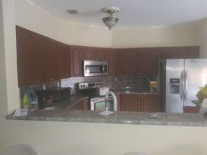Kitchen cabinets and formica counter top and a double sink for Sale in Miami, FL