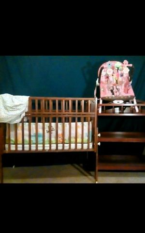 Fold away crib space saver, baby girl bouncer, brown wooden changing table no matt only mattress for crib for Sale in Austin, TX