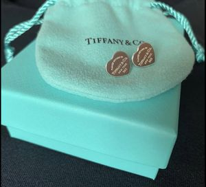 Return to Tiffany mini heart tag earrings in sterling silver for Sale in Rockville, MD