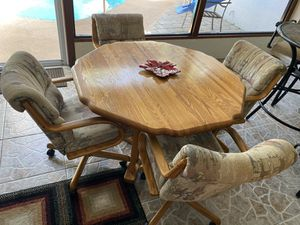 Dining Room Table with scalloped edges and 4 upholstered roller chairs for Sale in Melbourne, FL
