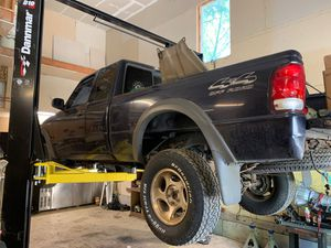 2000 ford ranger parting out trans for 4.0 transfer case head lights truck bed grill windows . doors rear slide window. Fenders will remove for u for Sale in Fox Island, WA