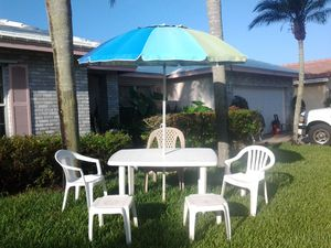 Outdoor weatherproof furniture with large table and large umbrella chairs and table for Sale in Pompano Beach, FL