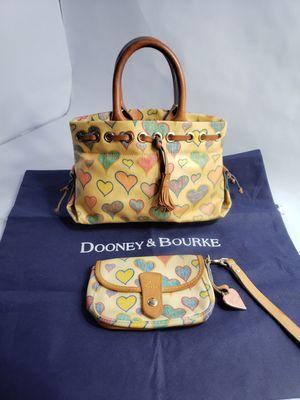 Dooney & Bourke Canvas handbag whit Wristlet Yellow Crayon Heart Logo for Sale in San Antonio, TX