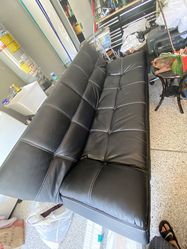Leather futon in great condition. Barely used.