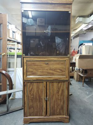 Cabinet with glass doors built in desk for Sale in Reading, PA