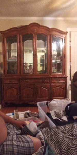 China cabinet wimirror on the back glass shelves 4 doors 3drawers and 4 cabinet doors on bottom with lights in the top for Sale in Monroe, LA