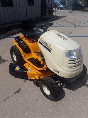 For sale a 42 inches cut deck 18hp Hydrostatic transmission cub cadet riding lawn mower for Sale in Elgin, IL