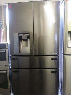 LG black stainless steel 4-door French style refrigerator for Sale in Cleveland, OH