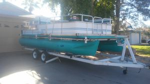 Pontoon boat 1986 20 foot has large. Outboard motor seats 8-10 people comes with trailer. 9900. for Sale in Tempe, AZ