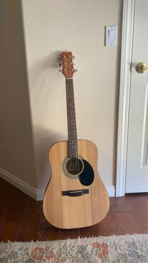 Acoustic guitar with capo for Sale in Las Vegas, NV
