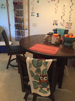 A solid wood dining table with rotating center and large storage place for Sale in Oshkosh, WI
