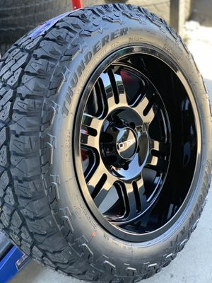 20x10 All gloss black rim and AT rugged terrain tires 6 lug Chevy gmc Nissan Toyota 2755520 for Sale in Modesto, CA