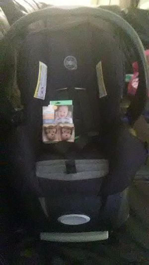 Evenflo car seat, with base, and brand new monkey straps for Sale in Lexington, KY