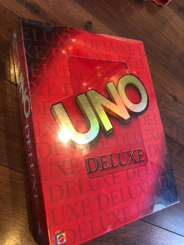 NEW uno deluxe game - gift - Ages seven and up for 2 to 10 players
