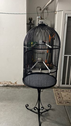 T 44 X R 78 nice clean good condition bird cage come with T 32 X R 78 nice clean good condition stand 2 dishes and carpet $ 99. for Sale in Hemet, CA