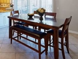 A beautiful glass top dining room table! 6 chairs and bench for Sale in Simi Valley, CA