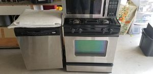 Kitchen appliances dishwasher stove microwave all go together for Sale in Brentwood, CA