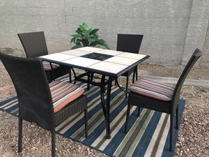 Patio furniture 4 wicker chairs with cushions and tile table great condition for Sale in North Las Vegas, NV