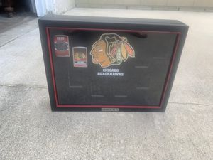 Black hawks zippo lighters with collectors box for Sale in Lakewood, CA