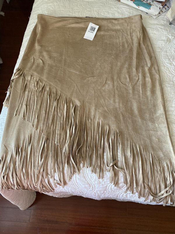 From Nordstrom, Soprano faux suede natural beige color skirt w/ cross cross fringe bottom,
