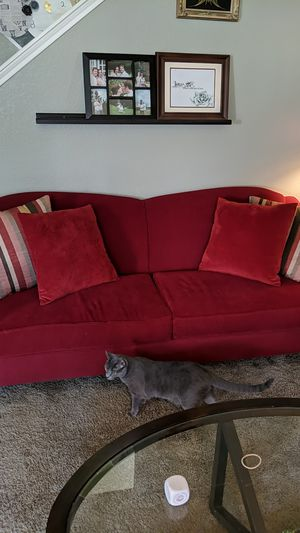 Red couch with pillows for Sale in Houston, TX