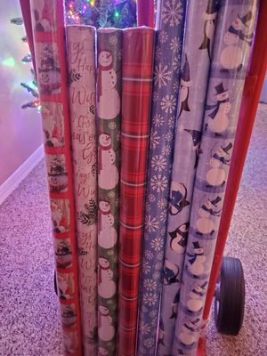 7 Rolls Of Christmas Paper 4 Tall Rolls and 3 Short Rolls for Sale in Lakeland, FL