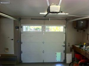 10'x7' insulated double faced garage door with dog window for Sale in Sanger, CA