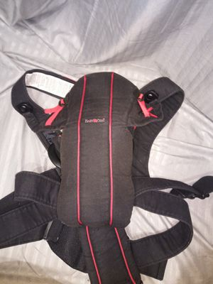 Red and black baby Bjorn baby carrier for Sale in Lawrenceville, GA