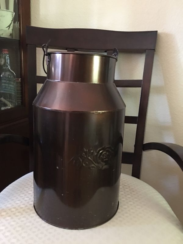 "Milk can tin about 16"" talk. Nice rose on each side. Decorative and used to hold scented pine cones in our home."