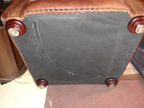Leather chair by Ashley