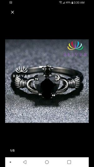 Clad agh. Ring silver & black size 6-9 Five dollars $5..00 for Sale in Northfield, OH