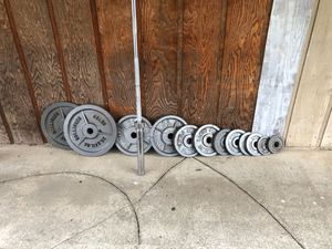 Olympic weights and 7 ft 45 lb bar with collars 45s 35s 25s 10s 5s 2.5s Barbell $60 includes collars Olympic weight set $180 Both together $220 pric for Sale in Federal Way, WA