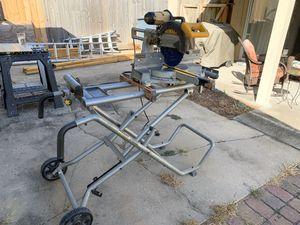 "12"" Dewalt sliding chop saw with portable stand for Sale in Fort Walton Beach, FL"