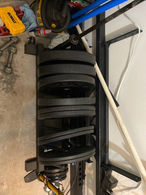 Olympic weight plates (Rogue), 35lb Olympic bar, small incremental weights, rolling weight rack, and barbell clamps for Sale in San Diego, CA