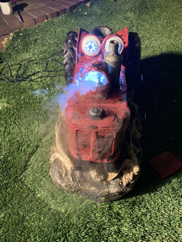 Tractor fountain with lights and fog