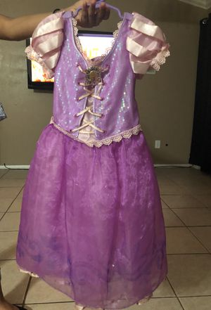 Rapunzel costume from Disney store for Sale in Spring, TX