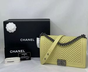 CHANEL Wrinkled Lambskin Chevron New Medium Boy Flap Shoulder Bag Yellow for Sale in Corona, CA