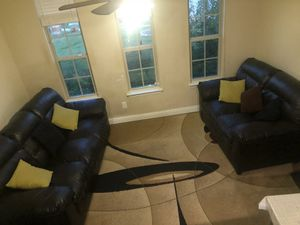 A leather sofa and a Loveseat for Sale in Sachse, TX